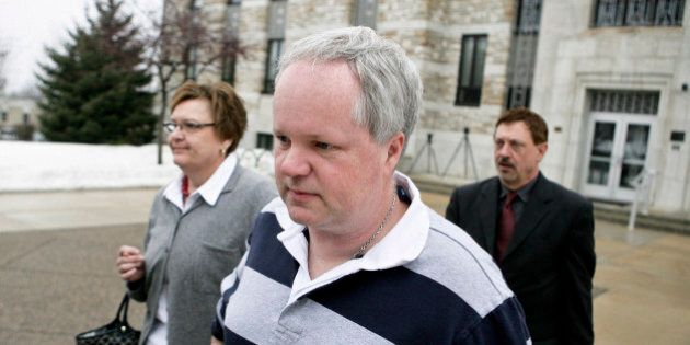 FILE - In this Feb. 17, 2011 file photo, William Melchert-Dinkel, center, leaves the Rice County Courthouse...
