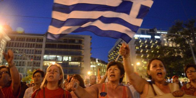 ATHENS, GREECE - 2014/07/03: The demonstrators accuse the Greek government of trying to sell a successful...