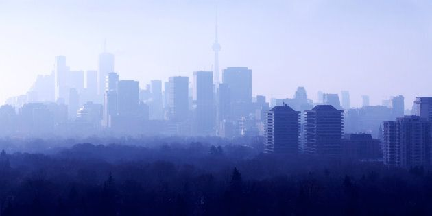 Midtown Toronto on a foggy morning, with downtown in the background. A recent poll found thathalf of Torontonians are hoping for house prices to fall, but a new report from Royal Bank of Canada basically says