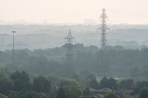 Power lines are seen through haze in Mississauga,