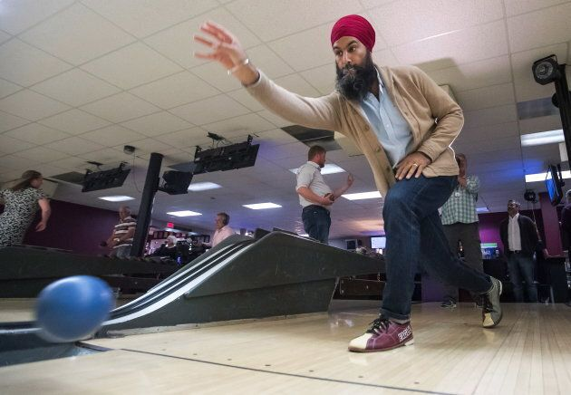 NDP Leader Jagmeet Singh bowls during a social outing with the NDP caucus after the first day of a three-day national strategy session in Surrey, B.C., on Sept. 11, 2018.