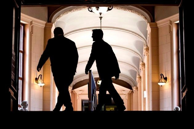 Premier Doug Ford and Prime Minister Justin Trudeau make their way to their talks at the Ontario Legislature,...