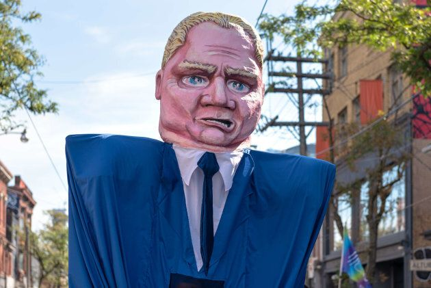 A sign depicting Ontario Premier Doug Ford during the Toronto Labour Day Parade on Sept. 3,