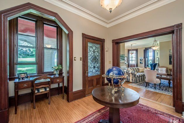 Original hardwood floors remain in many parts of the home.