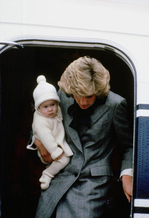 Diana carries Prince Harry off a flight at Aberdeen