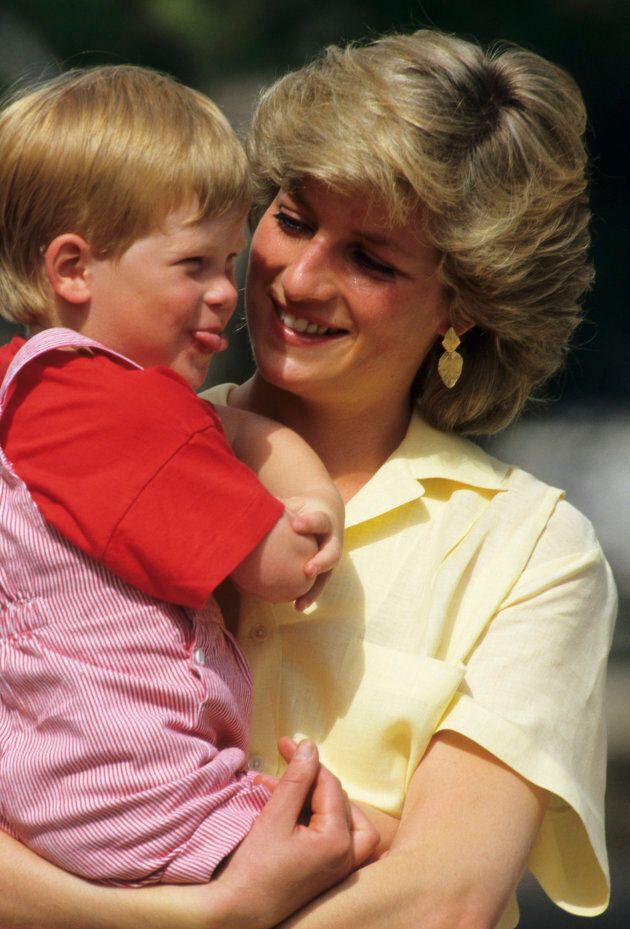 Princess Diana with Prince Harry while on holiday in Majorca, Spain, on August 10,
