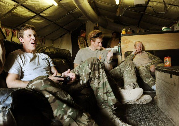 Prince Harry plays video games with Captain Simon Beattie, left, and Sargeant James John in the VHR (very...