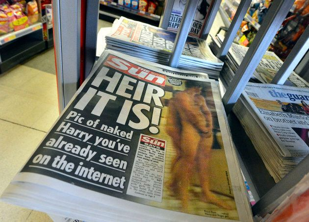 A copy of The Sun featuring a picture of a naked Prince Harry is seen in a shop in London on August 24,