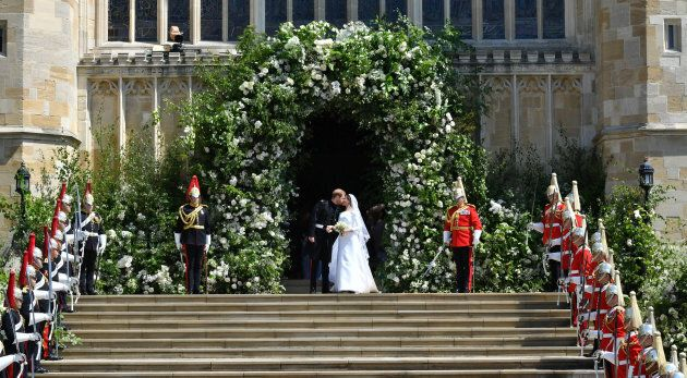 Prince Harry and Meghan Markle leave St George's Chapel in Windsor Castle after their wedding. Saturday...