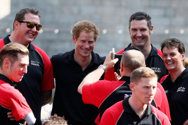 Prince Harry poses with members of the British Armed Forces Invictus Team during the Invictus Games in...