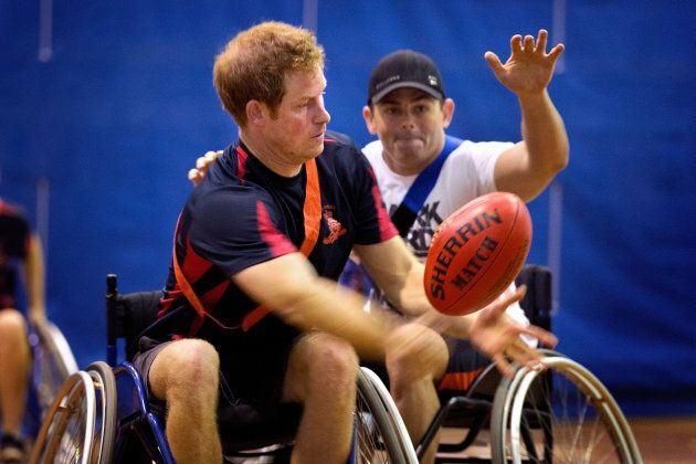Prince Harry passes the ball during a game of wheelchair football at the Soldier Recovery Centre on April...