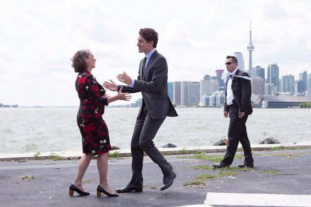 Prime Minister Justin Trudeau greets Toronto-Danforth Liberal MP Julie Dabrusin after making a funding...