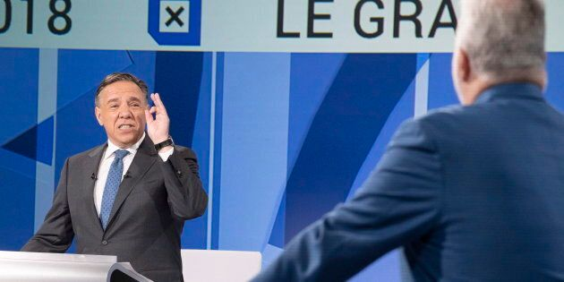 CAQ leader Francois Legault, left, questions Liberal leader Philippe Couillard during the leaders debate...