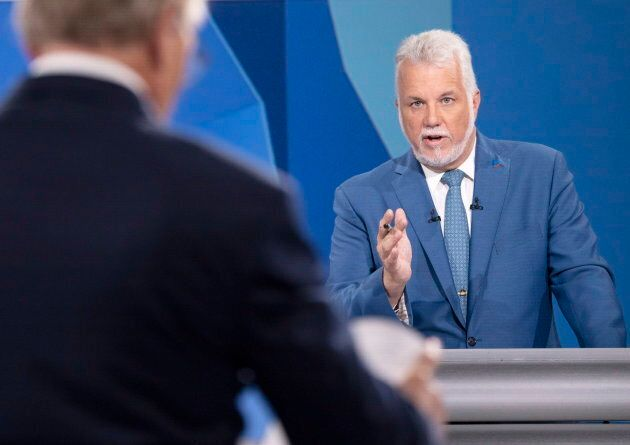 Liberal leader Philippe Couillard responds to PQ leader Jean-Francois Lisee during the leaders debate...