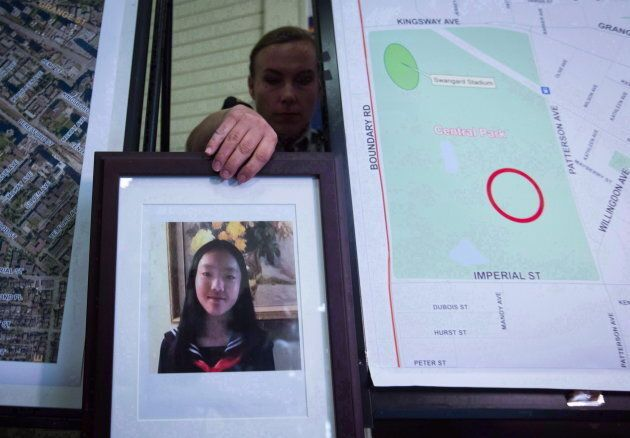 RCMP Cpl. Daniela Panesar places a photo of Marrisa Shen, 13, next to a map indicating where her body...