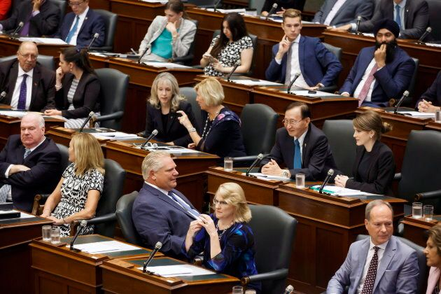 Ontario Premier Doug Ford sits with other PC party members inside Queens Park in Toronto on Sept. 15,