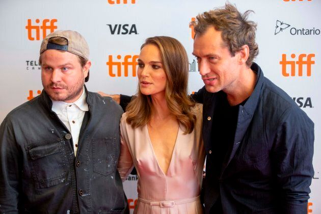 Director Brady Corbet poses with Natalie Portman and Jude Law at the premiere of their film 'Vox Lux' at the Toronto International Film Festival in Toronto, Ontario, September 7, 2018.