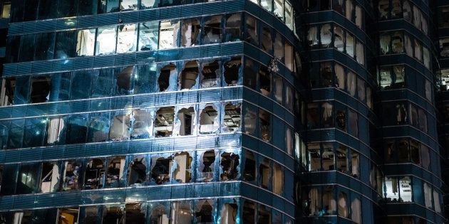 Windows of a commercial building damaged by Typhoon Mangkhut on September 16, 2018 in Hong Kong. City...