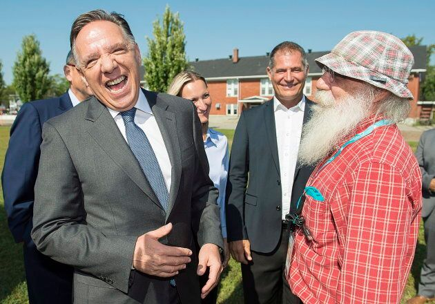Coalition Avenir Quebec leader François Legault laughs with a supporter in Coteau-du-Lac, Que. on Sept....