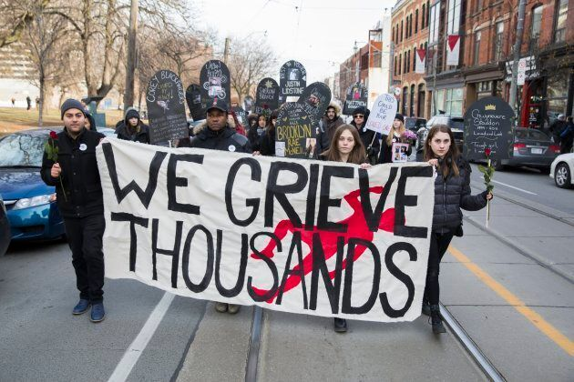 Protesters in Toronto walk to City Hall on Dec. 11, 2017, to call on Major John Tory to acknowledge the overdose crisis and the importance of safe injection sites like the one set up in Moss Park.