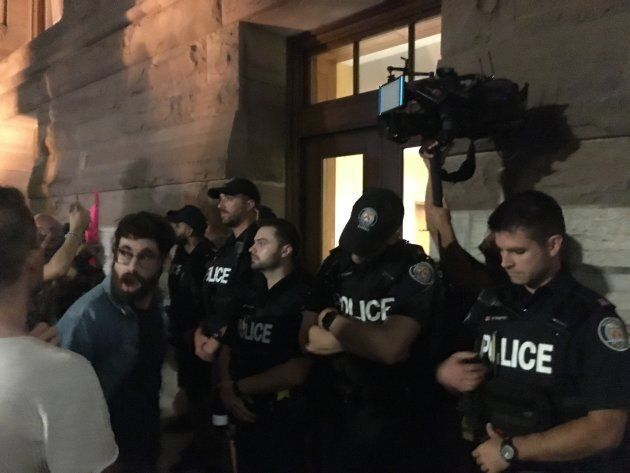 Police stand outside Toronto's Queen Park as protesters chanted on Sept. 17, 2018.