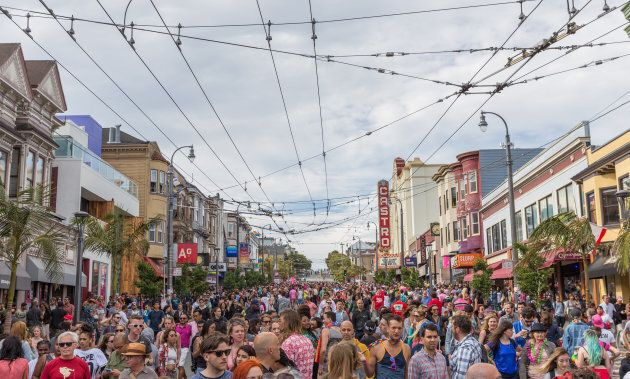 Individuals congregate in the Castro District for the annual Pride celebration on June 27,