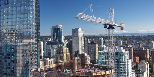 A high-rise building under construction in downtown Vancouver. Some experts say Canada's policymakers...