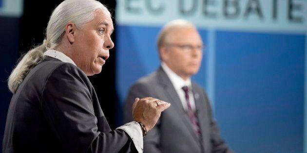 Parti Quebecois (PQ) Leader Jean-Francois Lisée listens as Quebec solidaire co-spokesperson Manon Massé...