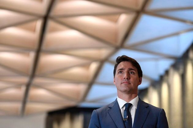 Prime Minister Justin Trudeau waits to be introduced before an an armchair discussion with Maclean's...