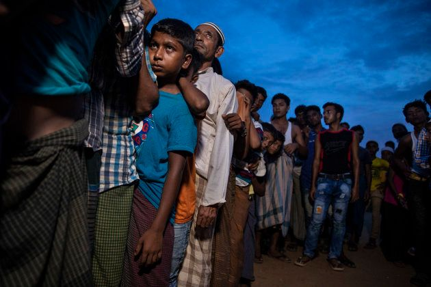 Rohingya wait in line for humanitarian aid in Kutupalong camp Aug. 27, 2018 in Kutupalong, Cox's Bazar, Bangladesh.