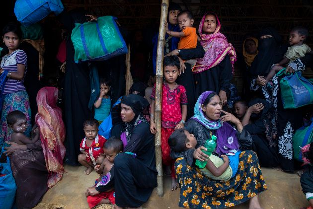 Rohingya women and children wait in line for a food distribution of super cereal on Aug. 26, 2018 in...