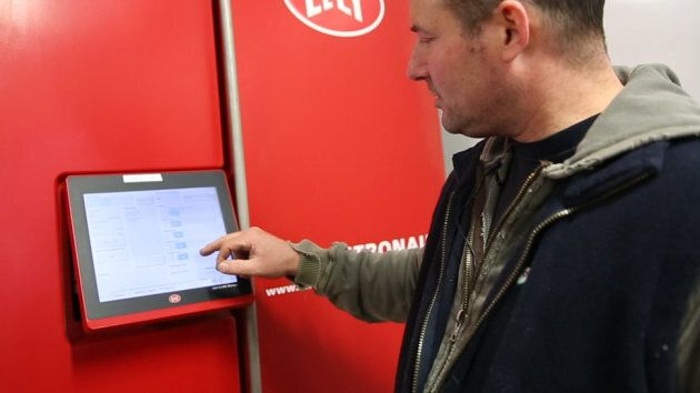 Pascal Thuot checks data on his dairy