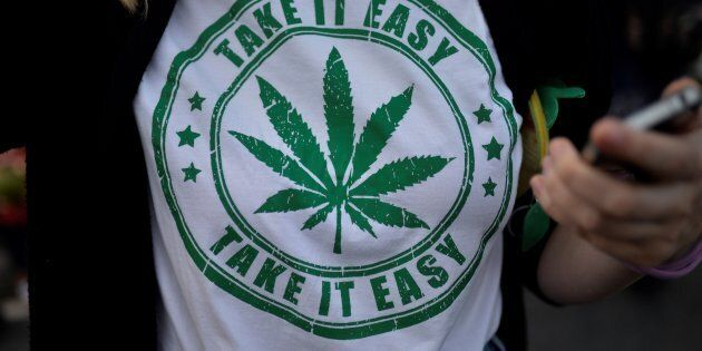 A woman wears a t-shirt featuring a cannabis leaf at the marijuana march in Ipanema, Rio de Janeiro,...