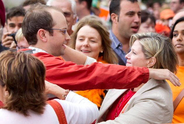 Toronto Coun. Mike Layton hugs Ontario NDP Leader Andrea Horwath at a labour day parade in