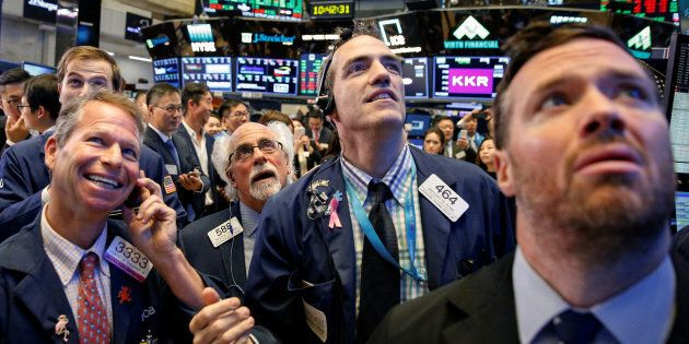 Traders watch stock prices on the floor of the New York Stock Exchange in New York, Sept. 19. Canadian...