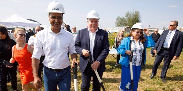 Infrastructure Minister Amarjeet Sohi and Kinder Morgan Canada president Ian Anderson, make their way...