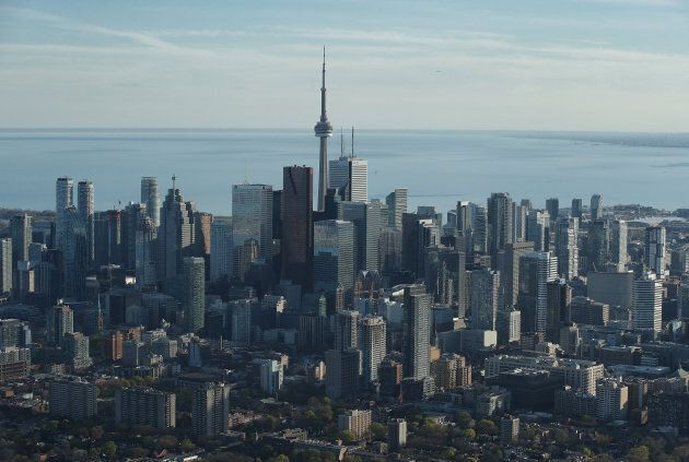 An aerial view of the Toronto city skyline and downtown buildings and Lake Ontario in the background...