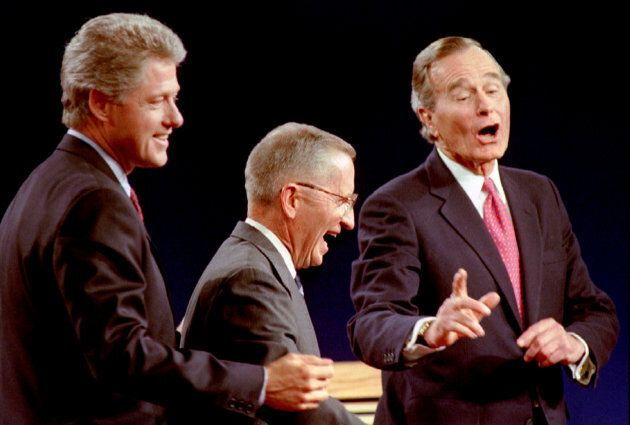 Bill Clinton, Ross Perot and George H.W. Bush laugh at the conclusion of their Presidential debate in...