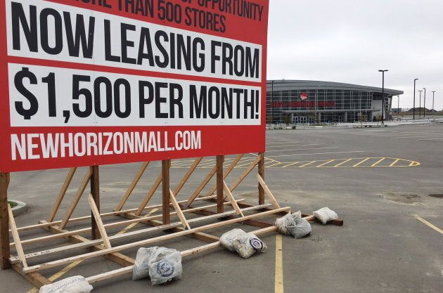 A sign is seen outside of the New Horizon shopping mall in Balzac,