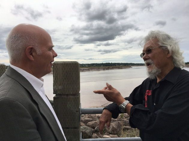 Environmentalist David Suzuki speaks with New Brunswick Green leader David Coon while overlooking the...