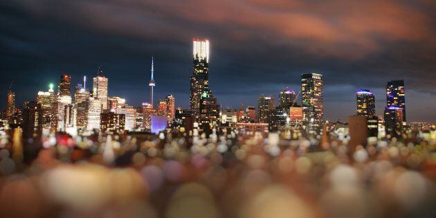 A tilt-shift image of central Toronto. A new forecast says the city's real estate market will return...