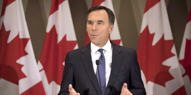 Federal Finance Minister Bill Morneau addresses journalists in Toronto on Aug. 30,