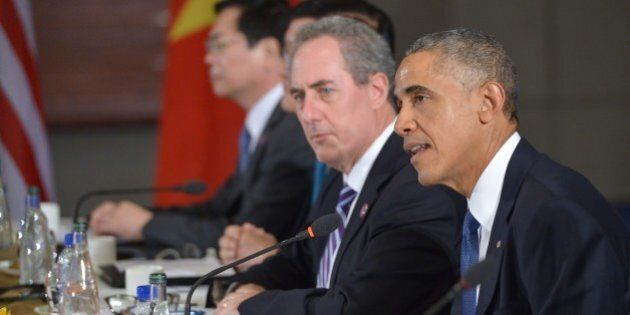 US President Barack Obama (R) speaks during a meeting with leaders from the Trans-Pacific Partnership...