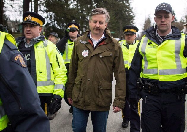 NDP MP Kennedy Stewart, centre, is arrested by RCMP officers after joining protesters outside Kinder...