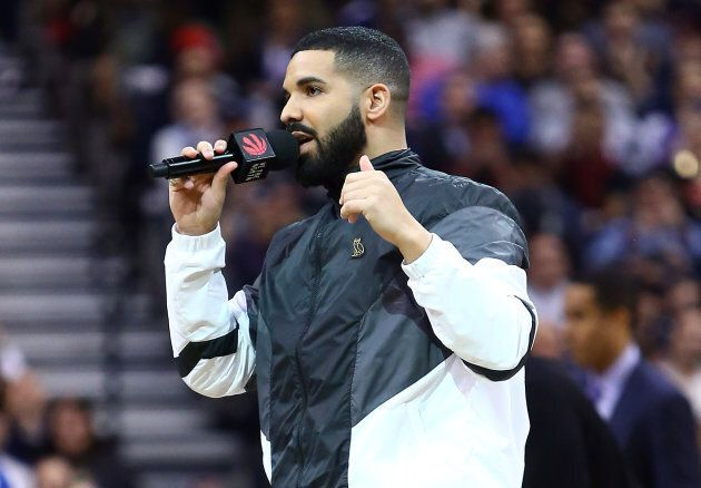 Drake, Toronto Raptors Ambassador, speaks to the crowd on 'Drake Night' during the first half of an NBA...
