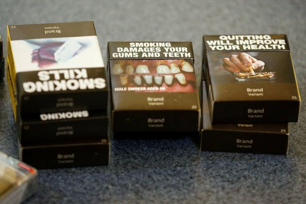 Mock-ups of plain cigarette packaging are seen before the start of a news conference in Ottawa on May...
