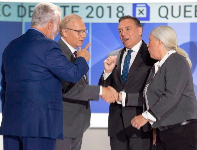 Liberal leader Philippe Couillard, left to right, PQ leader Jean-Francois Lisee, CAQ leader Francois Legault and Quebec Solidaire leader Manon Masse shake hands before their English debate Monday, September 17, 2018 in Montreal, Que.