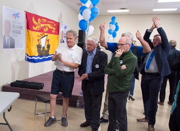 New Brunswick Progressive Conservative supporters watch early returns at leader Blaine Higgs' campaign...