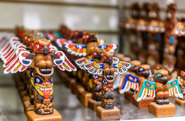 Carved totem pole souvenirs at a tourist shop in Vancouver Canada. Indigenous artist Jay Soule says most...