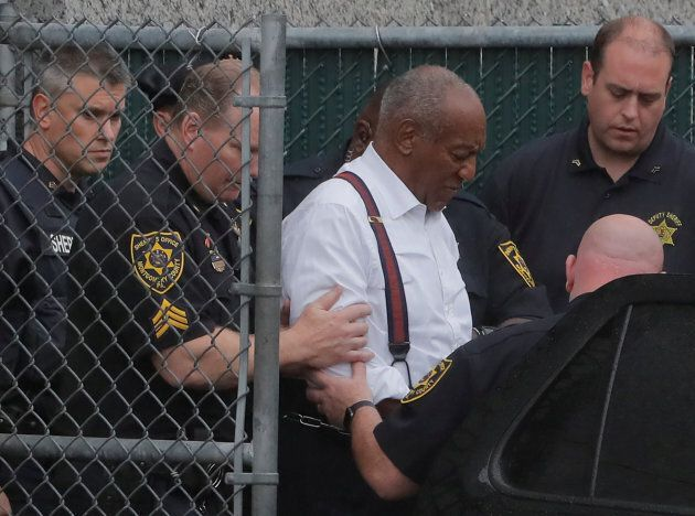 Bill Cosby leaves the Montgomery County Courthouse in handcuffs in Norristown, Pennsylvania on Sept....